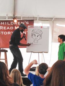 Author/illustrator Don Tate draws at an event.