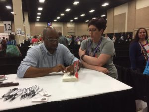 Kwame Alexander signs his book SOLO at TLA 2017