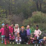 Erzsi Deak with children at Hutchison
